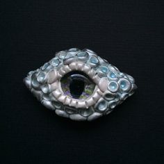 Icy Blue Dragon Eye Magnet by LunaPetals on Etsy https://www.etsy.com/listing/237384455/icy-blue-dragon-eye-magnet