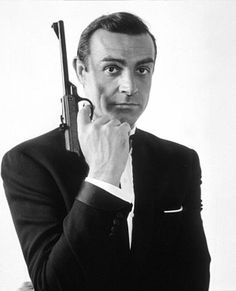 Sean Connery in the classic James Bond pose .Not sure if James Bond or Sean Connery is my style icon.They are the same people right? Sean Connery James Bond, James Bond Girls, James Bond Movies, Gary Oldman, Cary Grant, Photo Star, Montgomery Clift, Best Bond, Film Pictures