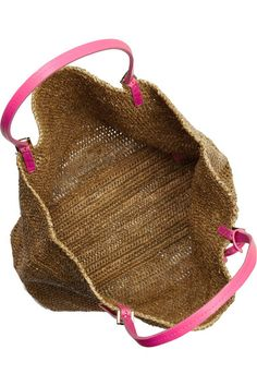 Natural raffia Two pink leather top handles Designer-stamped tag, feet Open top