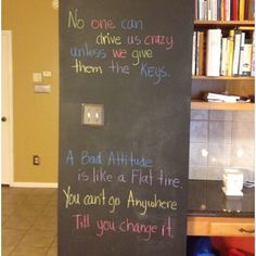 Chalkboard wall in the kitchen. Change quotes every week