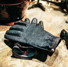 Grifter Onyx Ranger Wool Lined Glove  It's all about materials. The Onyx Ranger glove features a wool lining. The outer is made of American Mills Cone Selvedge black denim with the palm and fingers made of black deerskin. Made in the USA.