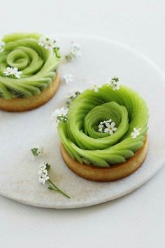 kiwi slices, probably set in ganache on pastry base (photo only)