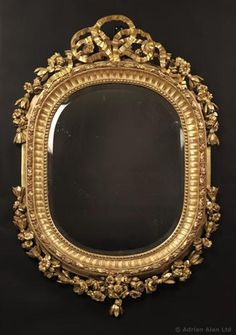 A Fine Louis XV Style Carved Giltwood Oval Mirror