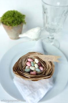 Paper Nest, table setting - so cute - one little paper bag makes two nests - all you need is scissors, a couple of brown paper bags and candy.  Happy Easter!