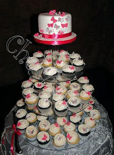 Assortment of vanilla and chocolate cupcakes all dotted with a single butterfly. Red velvet cutting cake with a cascade of silver and cerise butterflies. Vanilla And Chocolate Cupcakes, Red Velvet, Butterflies, Wedding Cakes, Dots, Holiday Decor, Desserts, Silver, Wedding Gown Cakes