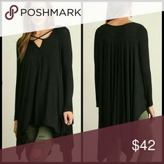 "Edith Black Tunic Color: black   Long sleeve tunic with handkerchief hemline and split neckline.   Model 5'11"" wearing small. Tops Tunics"