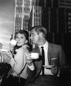 Audrey Hepburn and George Peppard drinking coffee.