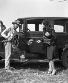 Picking the bird: An upper class society woman buying a turkey for the Thanksgiving table from a farmer in 1927