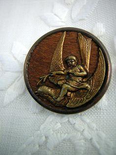 Putti Rides A Bird, antique picture button.