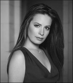 Holly Marie Combs (born December 3, 1973) is an American actress and television producer. She is best known for her roles as Piper Halliwell on The WB television series Charmed (1998–2006), and as Kimberly Brock on the CBS television series Picket Fences (1992–1996), which earned her a Young Artist Award.