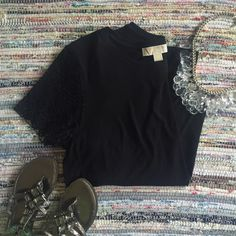 Michael Kors Lace Sleeve Tee Excellent condition, Michael Kors tshirt with lace sleeves. A bit longer in the back than front. Very cute style Michael Kors Tops Tees - Short Sleeve