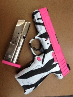 Zebra and hot pink gun. Even my dad admits this is cool
