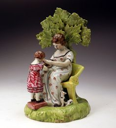Antique Staffordshire Figure of mother and child at play. c1820