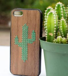 Merge your tech-savvy lifestyle and your love of handicraft with this DIY iPhone case. Each wooden phone case is laser-cut with holes in the shape of a cactus, laid out for to stitch your own succulent.