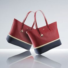 Happy Thanksgiving!    CELEBRATE WITH VISSI BAG SPECIAL EDITION    In honour of Thanksgiving, Bally has created this original colour version of Vissi, crafted in rich red and blue leather with an off-white trim. This special edition tote is a striking tribute to classic winter style.   Available exclusively online