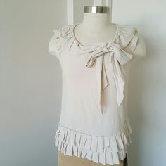"""Robert Rodriguez Beige Raffles Top.  one day Sale Very feminine top,  raffles on the top and bottom, lining 100% silk body 100% cotton.  Great with pants or skirt, been worn very gentle, great condition. Measurements are length 21"""" bust 36"""" Robert Rodriguez Tops Tank Tops"""