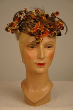 1950's Lilly Dache hat adorned with brown, green and orange velvet flowers and leaves.