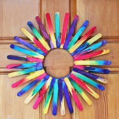 This funky DIY wreath is made from craft sticks and a paper plate. So easy it hurts!