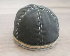 Early medieval woolen hat with tablet weaving