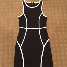 SAKs dress 5/48 (from Saks) black dress with white piping.  Perfect for going out or for the office (with a blazer).  Brand new without tags.  Size 4. Dresses