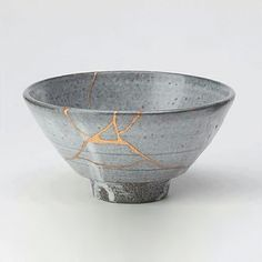 """kintsukuroi  (n.) (v.phr.) """"to repair with gold""""; the art of repairing pottery with gold or silver lacquer and understanding that the piece is more beautiful for having been broken."""
