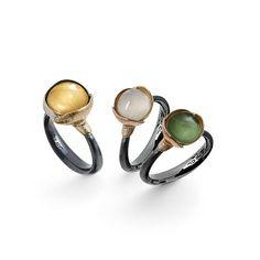 Lotus rings with individual gemstones designed by Charlotte Lynggaard. Ole Lynggaard Copenhagen.