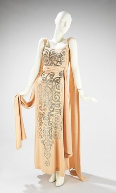 Sequined synthetic evening dress by Jeanne Lanvin, French, spring/summer 1937. This evening dress' silver sequin embellishment, composed in an overall spiraling pattern, shows a signature Lanvin style in its elegant simplicity.