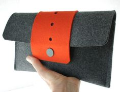orange! from fuzzy logic felt  http://www.etsy.com/listing/60350962/felt-clutch-in-orange-and-gray-merino