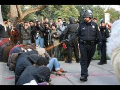 A police officer pepper-sprays Occupy protesters at the University of California These 75 Iconic Photos Will Define The Century So Far. Everyone Needs To See This. Wall Street, Camouflage, University Of California Davis, Davis California, Apple Help, 1 Gif, Powerful Images, Iconic Photos, Famous Photos