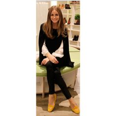 Who made Olivia Palermo's black cape sweater, white top, yellow shoes and black leather pants? | OutfitID