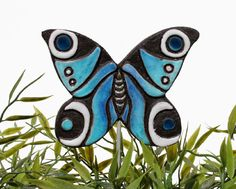 Hey, I found this really awesome Etsy listing at http://www.etsy.com/listing/156431040/butterfly-garden-decor-plant-stake