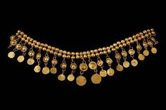 Description: Section of Necklace composed of 15 double beads and 22 pendants Material(s): Gold Date of Object: 330 BC Origin: Colchian
