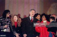 US President-elect Bill Clinton and his daughter chelsea join singers Michael Jackson and Diana Ross in the song 'We are the world' on January 17, 1993 at the Lincoln Memorial on the Washington Mall....