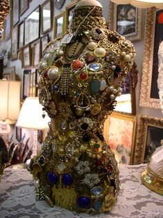 I had vintage decorative torso, used to display jewelry, but it was in terrible condition.  I bejeweled it and eventually had it made into a lamp.  It sold very quickly!