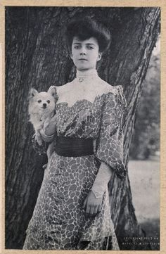 "Alice Roosevelt with her dog Leo - 1902  She smoked cigarettes in public and on the White House roof, chewed gum, placed bets with bookies, rode in cars with men, stayed out late partying, and kept a pet snake named Emily Spinach, which she often wore wrapped around one arm and took to parties.  Her father President Theodore Roosevelt once said of her ""I can either run the country or I can attend to Alice, but I cannot possibly do both."""