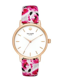 cheerful and chic, this kate spade new york metro watch features a classic white dial with rose gold-tone accents, complemented by a pink-and-grey rose print leather strap.