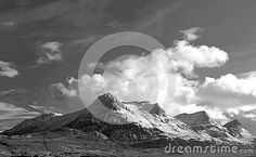 Black and white scenic view of Ben Loyal mountain in winter, Highlands, Scotland.