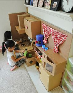 Create a cardboard play kitchen with...mostly just cardboard.