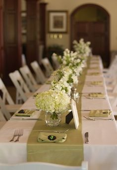 Long table with white low arrangements, white and green  love the simplicity