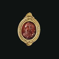 A GREEK GOLD AND CARNELIAN FINGER RING  HELLENISTIC PERIOD, CIRCA 330-300 B.C.