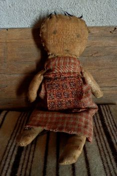 Prim doll - with minimal face and knotted hair...