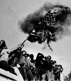 © AP Photo, Unknown photographer, Nov. 9, 1979, Demonstrators burn an American flag atop the wall of the U.S. Embassy where students have been holding American hostages since Nov. 4, Iran --- On Friday, September 27, 2013 United States President Barack Obama made a phone call to Iranian President Hassan Rouhani. The last direct conversation between the leaders of the United States and Iran was in 1979 before the Iranian Revolution toppled the pro-U.S. Shah and brought the Ayatollahs to…