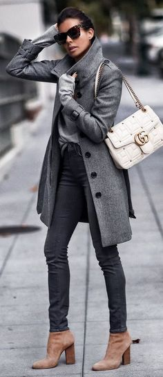 Charcoal grey coat, grey sweater, black skinny jeans, switch to black booties, white shoulder bag