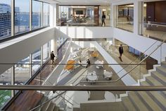 Light fills this office space by connecting floors with iconic stairs at the window line that offer spectacular views of the city and harbor and by vertically distributed destinations including roof terraces, 40+ conference rooms, a client conference center, a library, 200-seat cafeteria and servery and multi-purpose rooms. Workplace design. Designed by BH+A.