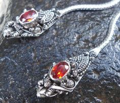 So Unique Sterling silver 925 Dragon Dangles with garnets for eyes