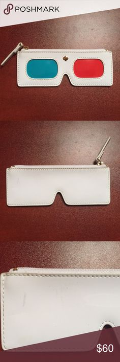 NWOT Cinema City 3D Glasses Coin Purse 100% Authentic Kate Spade Cinema 3D Glasses Coin Purse. This is SOLD OUT & very RARE! There are a few slight marks ok he back left side as seen in photo. It was a display & I do not have the original tags. Material: print on patent cowhide with slight crinkle trim. 14-karat light gold plated hardware. Custom woven caroleena spade dot lining. Features: coin holder with key fob and a zip top closure space stud. 3.5 inches height x 5.5 inches wide kate…