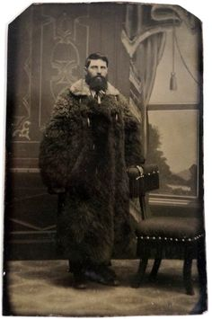 Tintype portrait of a man in a giant buffalo fur coat. c. 1880's #victorian
