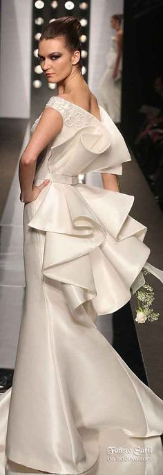 Fausto Sarli SS 2010...Absolutely GORGEOUS!!!. Cheaper to have custom-made than purchasing from salon. Trying different fabric combination to fit your wedding theme BUT Work with your seamstress to achieve this look.