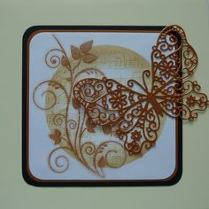 Embossed swirly leaf stamp from Clarity Stamps with Tattered Lace butterfly die cut