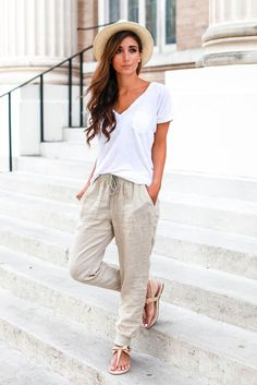 spring / summer - street chic style - beach style - comfy style - summer outfit ideas - spring outfit ideas - white v-neck tee + beige drawstring joggers + nude sandals + cream and black fedora